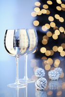 Two silver wine glasses printed with Christmas motifs