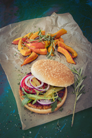 A burger with grilled pumpkin wedges on the side 11047055018| 写真素材・ストックフォト・画像・イラスト素材|アマナイメージズ