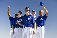 Baseball team, in blue uniforms, celebrating victory post match, arms up, smiling, front view, portrait 11080009818| 写真素材・ストックフォト・画像・イラスト素材|アマナイメージズ