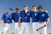 Baseball team, in blue uniforms, standing side by side, arms around each other, smiling, front view, portrait 11080009819| 写真素材・ストックフォト・画像・イラスト素材|アマナイメージズ