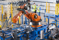 Businessman and worker controlling robotic machinery lifting steel fencing on production line in manufacturing plant 11080013098| 写真素材・ストックフォト・画像・イラスト素材|アマナイメージズ
