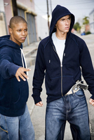 Portrait of two young street gang members 11080016094| 写真素材・ストックフォト・画像・イラスト素材|アマナイメージズ