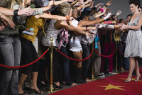 Celebrity signing autograph for screaming fans 11080020242| 写真素材・ストックフォト・画像・イラスト素材|アマナイメージズ