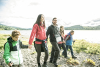 A family of five walking on the shore of Bala Lake in Wales.