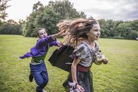 Children chase a girl dressed as a zombie prom queen for Halloween Night. 11082000500| 写真素材・ストックフォト・画像・イラスト素材|アマナイメージズ