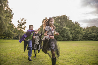 Children chase a girl dressed as a zombie prom queen for Halloween Night. 11082000501| 写真素材・ストックフォト・画像・イラスト素材|アマナイメージズ