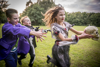 Children chase a girl dressed as a zombie prom queen for Halloween Night. 11082000503| 写真素材・ストックフォト・画像・イラスト素材|アマナイメージズ
