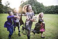 Children chase a girl dressed as a zombie prom queen for Halloween Night. 11082000504| 写真素材・ストックフォト・画像・イラスト素材|アマナイメージズ