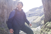 A mountaineer standing in rugged terrain. 11082001788| 写真素材・ストックフォト・画像・イラスト素材|アマナイメージズ