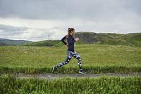 Happy confident young women running on an unmade road in southern Iceland