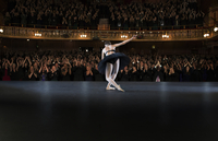 Ballerina  bowing on stage in theater
