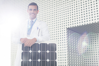 Portrait of scientist with solar panel in laboratory