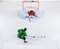 Overhead view hockey player practicing with goalie shooting puck at goal net 11086027990| 写真素材・ストックフォト・画像・イラスト素材|アマナイメージズ