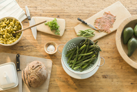 Overhead view lox, asparagus, pasta, bread and butter on dining table 11086028769| 写真素材・ストックフォト・画像・イラスト素材|アマナイメージズ