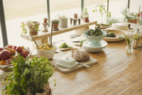Bread, butter, fruit, pasta,asparagus and fresh herbs on dining room table 11086028784| 写真素材・ストックフォト・画像・イラスト素材|アマナイメージズ