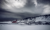 Church in remote snow covered landscape below stormy sky, Vik, Iceland 11086031944| 写真素材・ストックフォト・画像・イラスト素材|アマナイメージズ