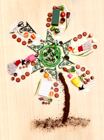 Still life concept gardening supplies forming windmill tree