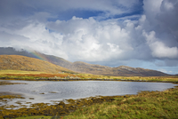Tranquil view clouds and rainbow over rolling hills beyond lake, Loch Aineort, South Uist, Outer Hebrides 11086032874| 写真素材・ストックフォト・画像・イラスト素材|アマナイメージズ