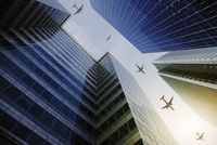 Airplanes flying in a row over highrise buildings, travel concept