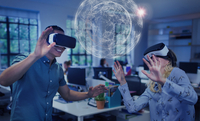 Computer programmers testing virtual reality simulator glasses, viewing futuristic hologram 11086039874| 写真素材・ストックフォト・画像・イラスト素材|アマナイメージズ