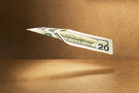 20 dollar bill folded into paper airplane