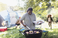 Woman barbecuing at campsite