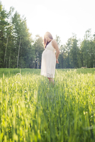 Pregnant woman standing in a field