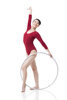 Female rhythmic gymnast performing with hoop