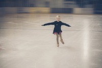 Young female figure skater moving on ice rink at competition 11094021288| 写真素材・ストックフォト・画像・イラスト素材|アマナイメージズ