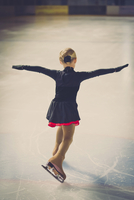 Young female figure skater moving on ice rink at competition 11094021289| 写真素材・ストックフォト・画像・イラスト素材|アマナイメージズ