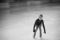 Young female figure skater moving on ice rink at competition 11094021290| 写真素材・ストックフォト・画像・イラスト素材|アマナイメージズ