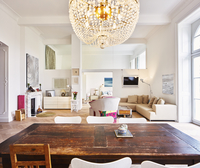 Living room in a refurbished old building with dining table 11094024670| 写真素材・ストックフォト・画像・イラスト素材|アマナイメージズ