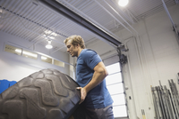 Man flipping tire in Crossfit gym