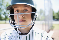 Close up portrait confident middle school girl softball player wearing batting helmet