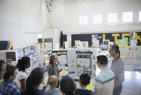 Middle school students and parents watching alternative energy presentation at science fair 11096053973| 写真素材・ストックフォト・画像・イラスト素材|アマナイメージズ