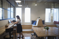 Female designer working at laptop in coworking space office 11096057080| 写真素材・ストックフォト・画像・イラスト素材|アマナイメージズ