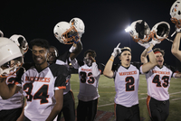 Teenage boy high school football team cheering, celebrating and holding helmets on football field 11096057356| 写真素材・ストックフォト・画像・イラスト素材|アマナイメージズ