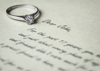 Engagement ring on letter