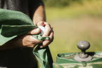 Man cleaning golf ball