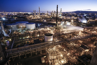 High angle view of illuminated petrochemical plant against blue sky 11100055354| 写真素材・ストックフォト・画像・イラスト素材|アマナイメージズ
