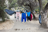 Wetsuits drying on clothesline at campsite