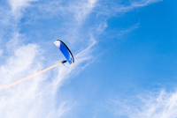 Low angle view of hiker powered paragliding against sky 11100070570| 写真素材・ストックフォト・画像・イラスト素材|アマナイメージズ
