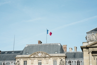 Low angle view of French Flag on building against sky 11100073288| 写真素材・ストックフォト・画像・イラスト素材|アマナイメージズ