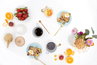 High angle view of food, drink and flowers over white background 11100073388| 写真素材・ストックフォト・画像・イラスト素材|アマナイメージズ