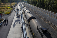 High angle view of freight train on railroad tracks during sunny day 11100073613| 写真素材・ストックフォト・画像・イラスト素材|アマナイメージズ