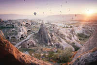 Hot air balloons flying over landscape against sky during sunset 11100080511| 写真素材・ストックフォト・画像・イラスト素材|アマナイメージズ