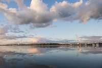 Factories by lake against cloudy sky 11100083310| 写真素材・ストックフォト・画像・イラスト素材|アマナイメージズ