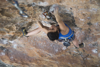 Female hiker rock climbing