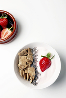 Overhead view of breakfast with strawberries over white background 11100090667| 写真素材・ストックフォト・画像・イラスト素材|アマナイメージズ