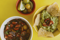 Overhead view of salsa and guacamole served with ingredients on yellow background 11100090716| 写真素材・ストックフォト・画像・イラスト素材|アマナイメージズ